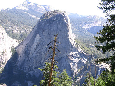 Liberty Cap, a small granite dome south of Half Dome, and the top portion of Nevada Fall.