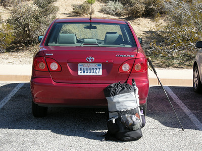 At the Cottonwood trailhead, preparing to depart. Car is a slightly-dented but quite satisfactory (if you could overlook the aroma of the interior) Toyota Corolla CE (with manual windup windows) from Rent-A-Wreck; it got 41 MPG on this trip! Pack starting weight was 39 pounds, with about 6 pounds of food & drink, 19 pounds of water, and full raingear including umbrella.