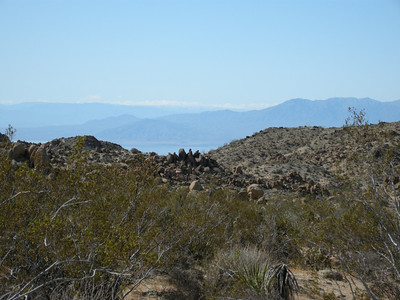 In the distance, a view of the Salton Sea and mountains south & west of Palm Springs.