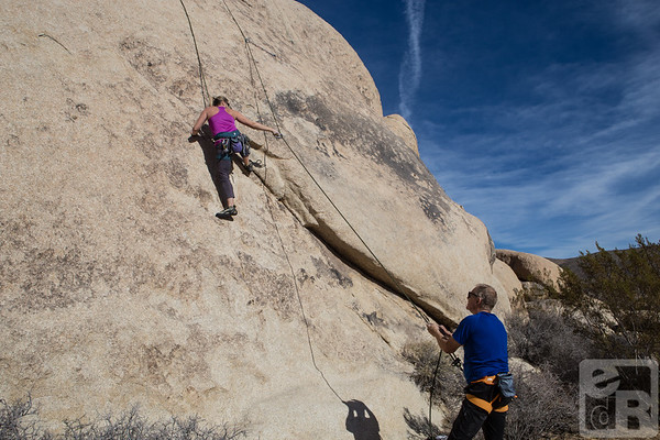 Michele climbing, John belaying