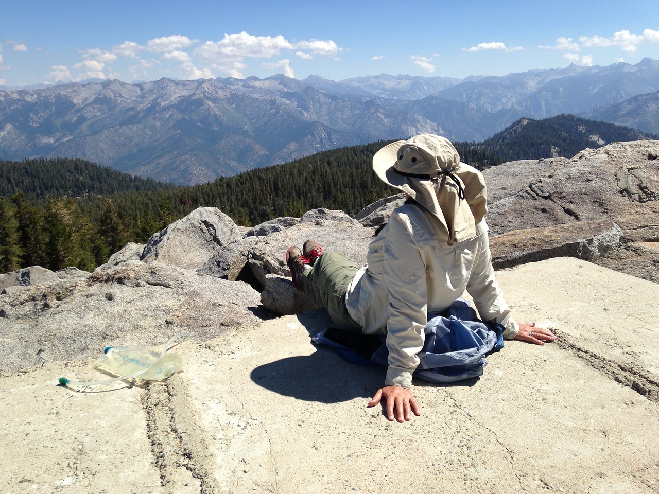 Michèle takes in the view atop Mitchell Peak, elevation 10, 365 feet.. The flat surface is concrete, almost all that remains of a fire lookout from the 1960s.