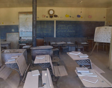 View through glass window into an elementary-school classroom.