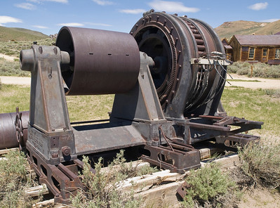 Electric generator, moved from the hydroelectric plant to Bodie.  I believe that a belt on the cylinder at the left was coupled to some sort of water wheel, turning the shaft and producing electricity in the generator on  the right.