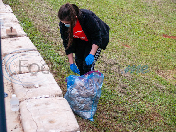 Glass Recreation Center - removing the paper from concrete bags at the bridge