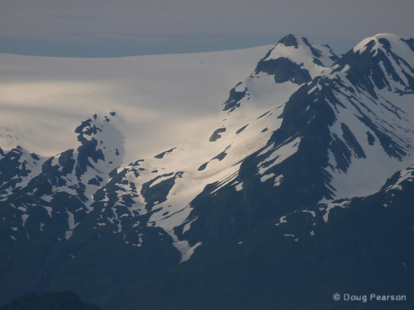 Ice capped hills surround Kenai Fjords near Seward Alaska