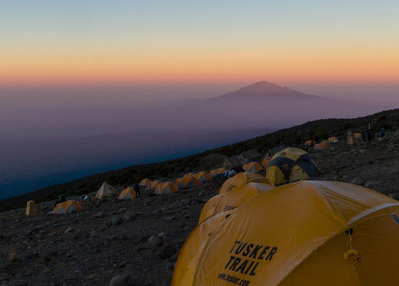 Sun rising on Mt. Meru, in the distance.