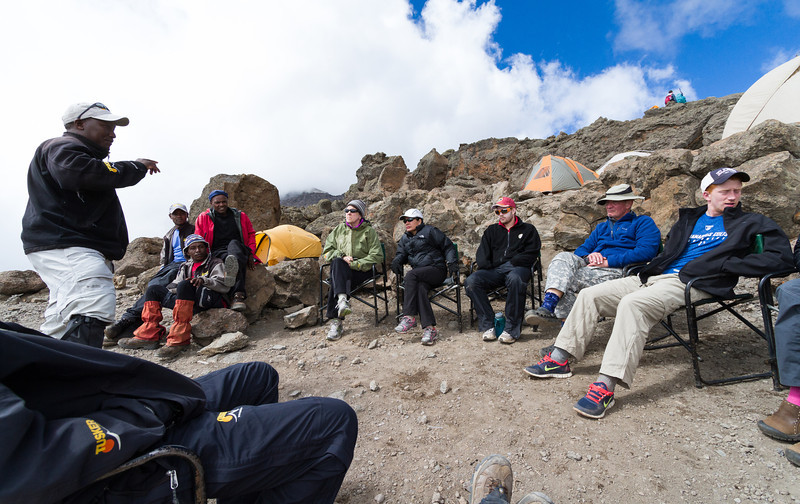 Pre-summit pow-wow to assess everyone's fitness for the last leg to the summit (4000+ vertical feet, starting at 15,000).