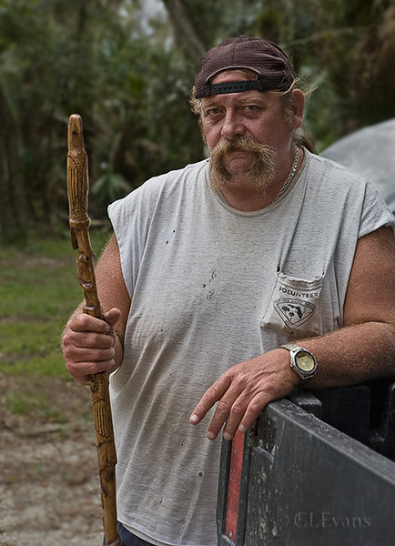 Jeff Lachar, a volunteer at Kissimmee Prairie Preserve SP, was photographed at his camp site holding one of his hand carved walking sticks.<br /> Sad to learn from his brother that Jeff passed away in September 2011.