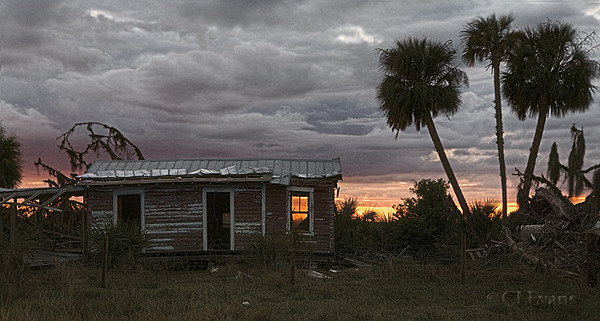 "Old Florida Cracker house at sunset (Kissimmee Prairie Preserve)<br /> <br /> This wooden building is an original Cracker house on a ranch that borders the entrance to Kissimmee Prairie Preserve. The tin roof and the house show hurricane damage.  If you are interested in learning about Florida Crackers, this web page is a good starting point:<br /> <br /> <a href=""http://homepages.rootsweb.com/~fcc/main/what"">http://homepages.rootsweb.com/~fcc/main/what</a>'s_a_cracker.htm"