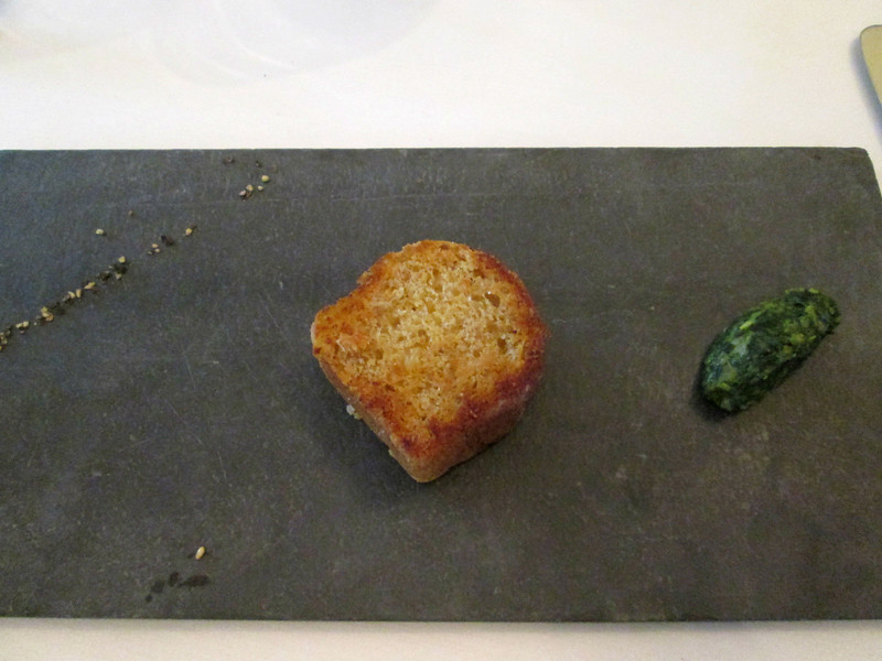 part of course #11:  served on a piece of slate: cracked black pepper, homemade brioche (made only a couple hours earlier) from some kind of heirloom grain, and zuccini marmalade