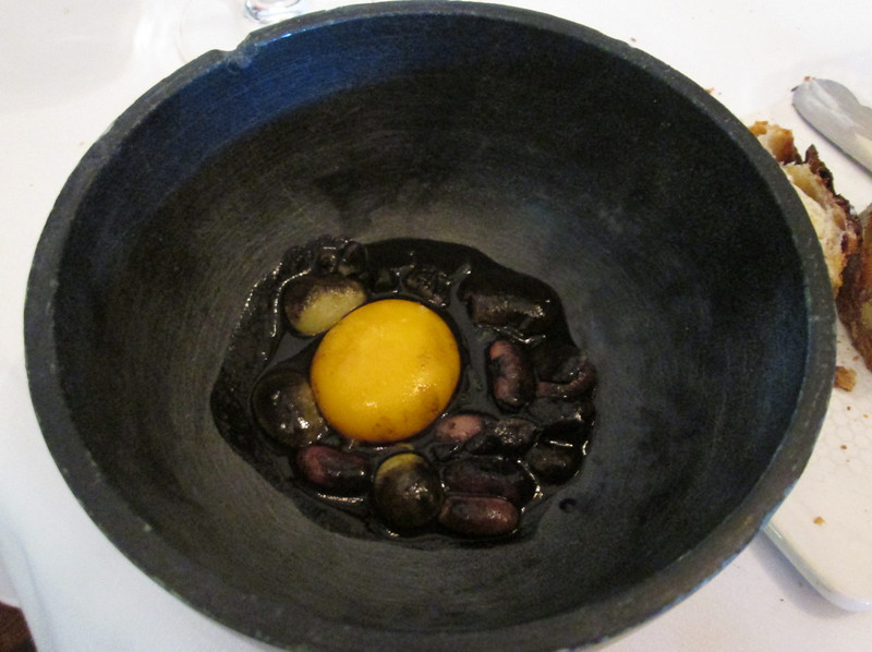 Course #14: fresh egg yolk and beans, cooked with charcoal.  A word about the charcoal (we had it before in the whoopee pie) - the Farm produces biochar, which a pure form of carbon that is free of the volatile chemicals and ash found in charcoal - it is made from tree branches, used paper plates and other biomass on the farm.  The chefs cook with biochar.  It had a definite charcoal-type taste, but was not overpowering and in fact added to the complex flavors in this dish.