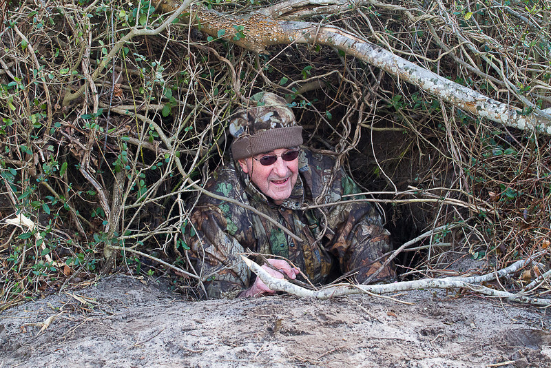 John Henderson checks out an active bear den.  Luckily it was empty at this time.