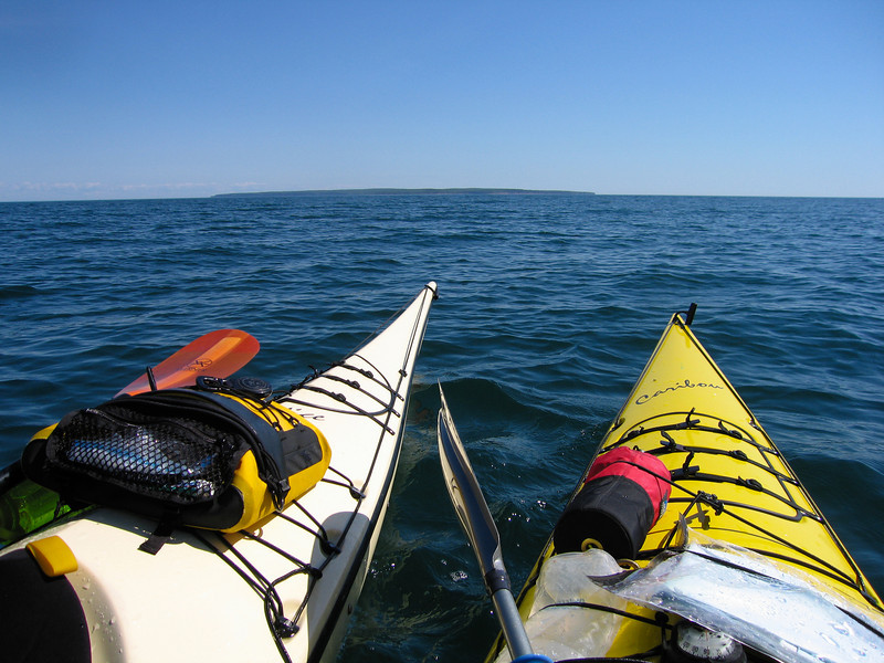 Sea kayaking the Apostle Islands. Contemplating the 3.5 mile crossing to Outer Island from the northern point of Stockton Island, July 3rd, 2008.