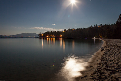 Night shot on the beach at Meeks Bay, looking south. Full moon.