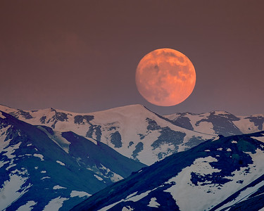 This telephoto photograph of a Denali moonrise was captured along the Denali Park Road in Denali National Park in Alaska (5/09).  This photograph is protected by the U.S. Copyright Laws and shall not to be downloaded or reproduced by any means without the formal written permission of Ken Conger Photography.