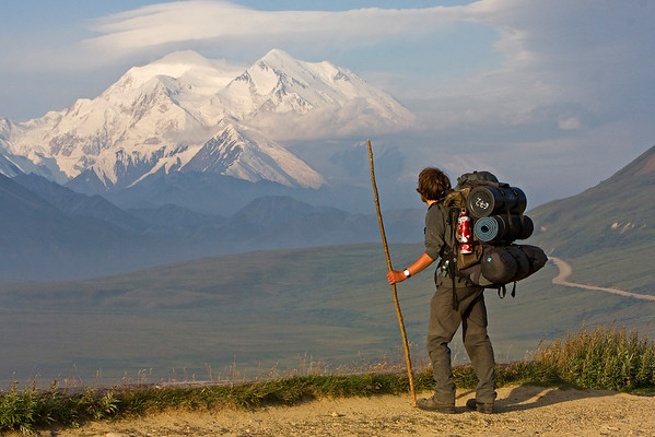 This photograph of lone hiker gazing upon Mt. McKinley was captured in the Stony area of Denali National Park, Alaska off of the park road (7/09).  This photograph is protected by the U.S. Copyright Laws and shall not to be downloaded or reproduced by any means without the formal written permission of Ken Conger Photography.