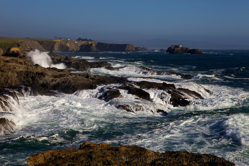 The Pacific Ocean surges over the rocks of the Mendocino coastline near the Pacific Star Winery.