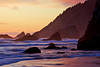 A long exposure shows the movement of the waves at sunset below Ecola State Park on the Oregon Coast.
