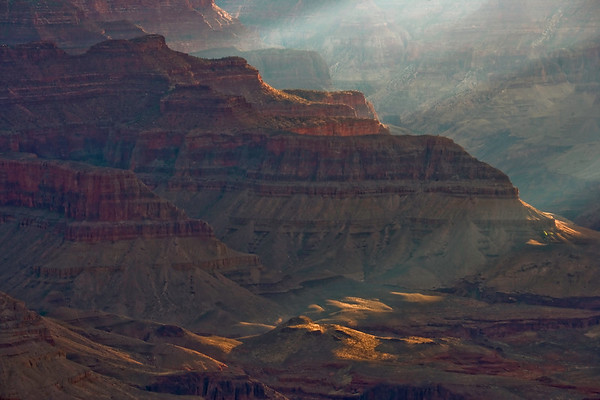 Sun streaks into the Grand Canyon revealing a myriad of formations and colors.
