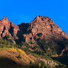 Sunrise dances on the ridges above Maroon Lake, in the Maroon Bells Wilderness area.