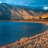 A morning rainbow arches into the sky by Twin Lakes between Leadville and Aspen.