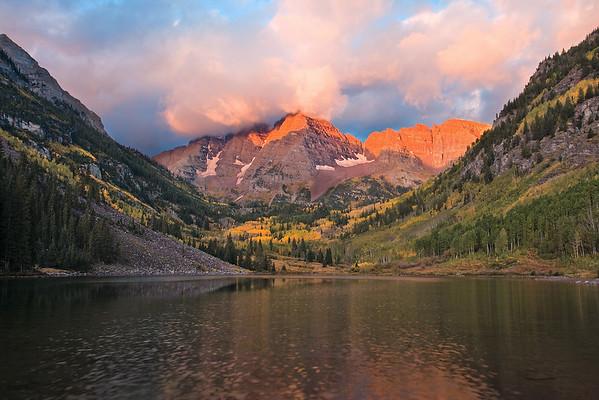 Sunrise touches the Maroon Peaks as autumn colors begin their perennial show.