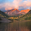 Sunrise touches the Maroon Peaks as autumn colors begin their perennial show.