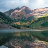 Reflection of Maroon Bells and fall colors, in Maroon Lake near Aspen, Colorado.