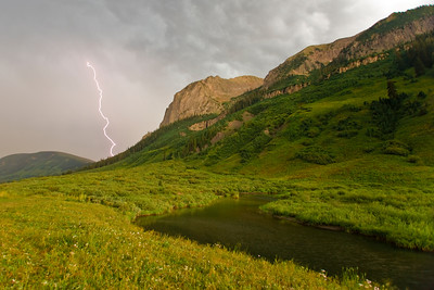 Lightning dances through the summer sky off Gothic Road near Crested Butte, Colorado.