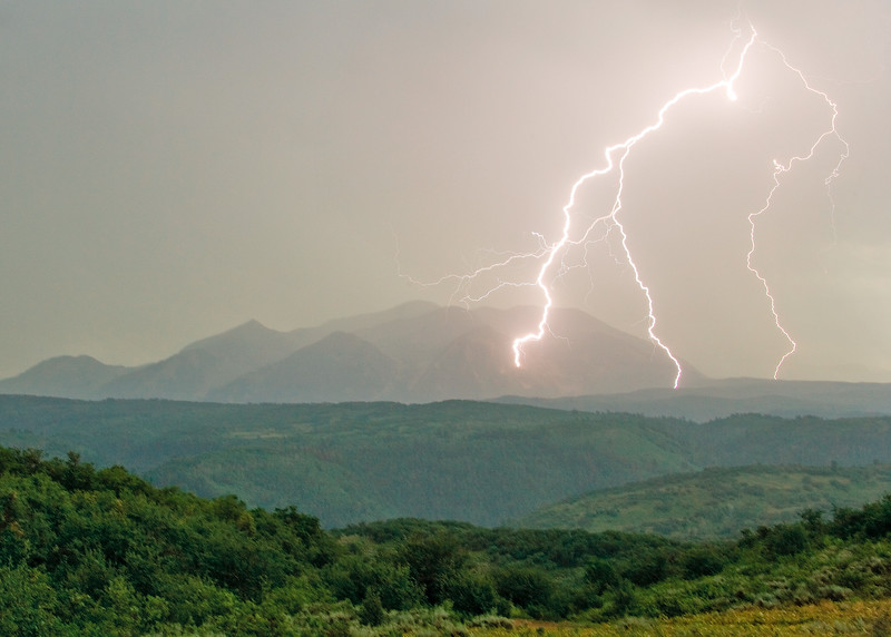 Lightning strokes from a single bolt  dance across great distance to strike near Beckwith Peak  off Kebler Pass.
