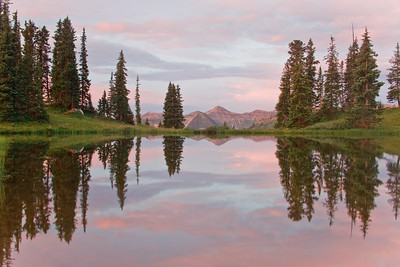 Augusta Mountain and Purple Mountain reflect in a small pond on Paradise Divide between Aspen and Crested Butte.