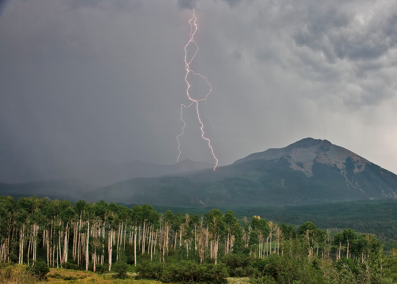 Lightning tendrils  dance across great distance to strike near Beckwith Peak off Kebler Pass.