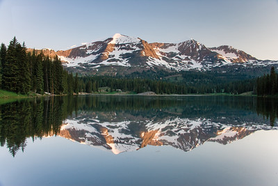The Snow capped Ruby Range reflect in Lake Irwin near Crested Butte, Colorado.