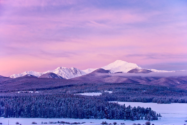 Clearing winter storm reveals Byers' Peak outside Winter Park, Colorado on a cold, snowy morning.