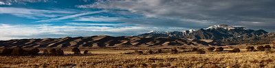 "Panoramic view of Great Sand Dunes National Park and Preserve and the Sangre de Cristo Mountains. This image is a stitch  of three images and is  sized 48"" x 16"""