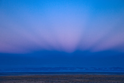 Sunrise creates antisolar rays to the west over the San Luis Valley near Alamosa and The Great Sand Dunes National Park and Preserve.  Antisolar rays are sometimes seen in the direction opposite the sun, converging to the antisolar point.