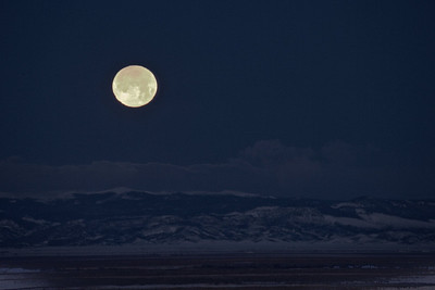 Moonset over the San Luis Valley near Alamosa and The Great Sand Dunes National Park and Preserve.