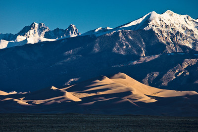 Sunrise reveals the dunes and the Sangre de Cristo Mountains from Great Sand Dunes National Park and Preserve.