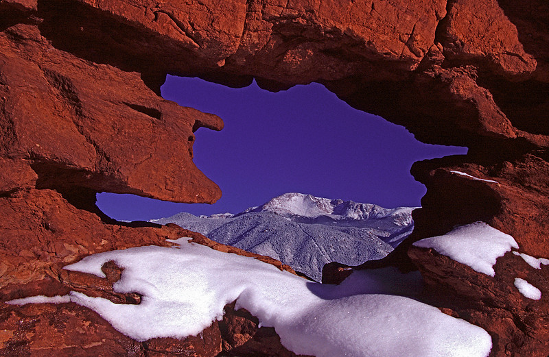 Rocks at the Siamese Twins formation  frame Pikes Peak from