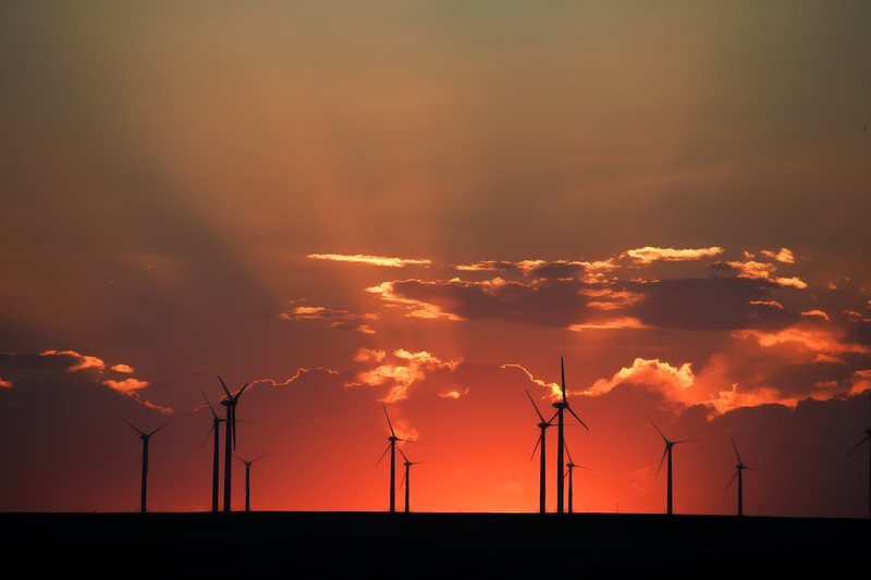 Wind turbine farm is silhouetted by a blazing sunset at Pawnee Buttes, in Pawnee National Grasslands, north of Greeley Colorado. Photo highly commended in Nature's Best 2008 Annual Edition.