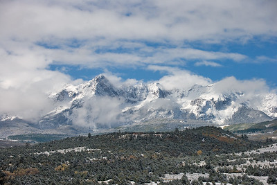 Clearing fog the morning after an early fall snow storm on the Sneffels Range. Viewed from Dallas Divide outside Ridgway, Colorado.