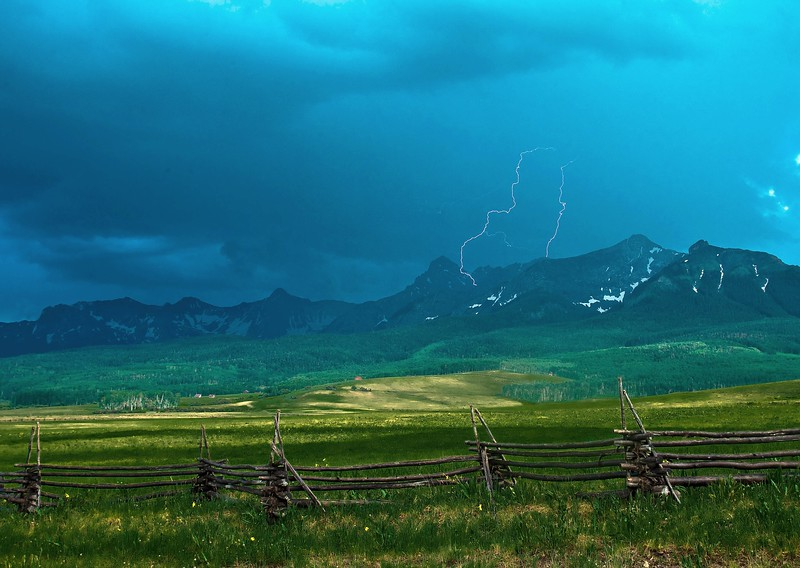 Mid-summer thunderstorm and lightning over the Sneffles Range from Last Dollar Road