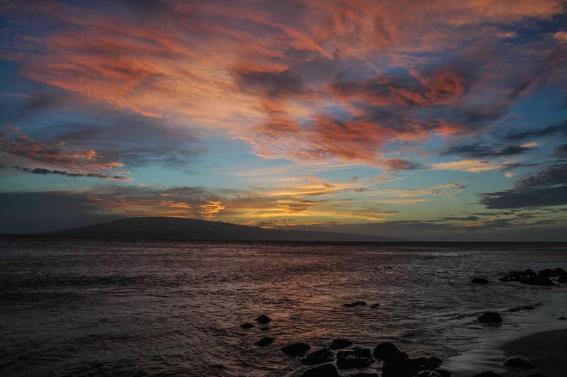 Sunset over Lanai from Maui's Kaanapali beach.