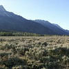 Grand Tetons above Wyoming shrublands.
