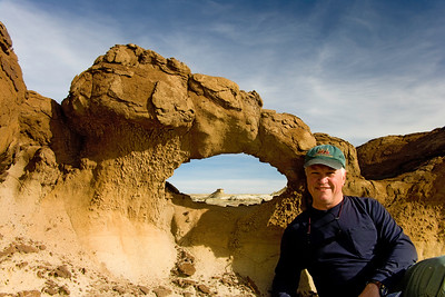 Arch in  Bisti Badlands -  Bisti de Nat Zin near Farmington, New Mexico. Photographer slacking off.