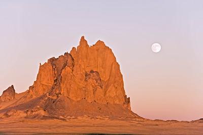 Full moon of autumn rises over Shiprock near Farmington, New Mexico.