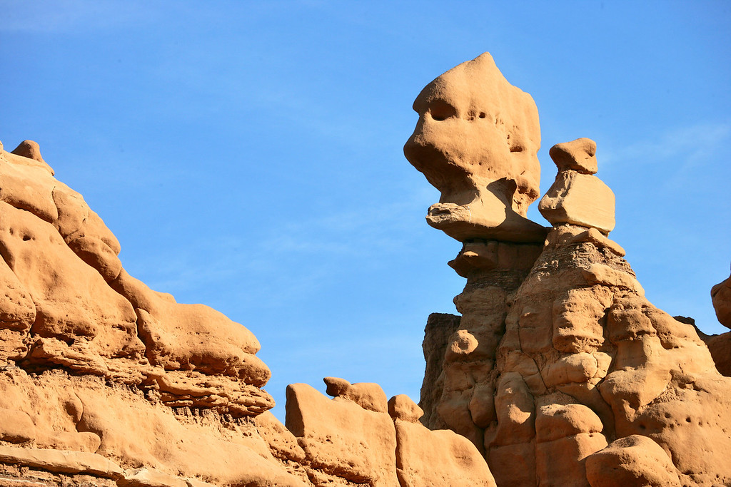 A goblin and his helper look over Goblin Valley State Park near Hanksvillle and Green River, Utah.