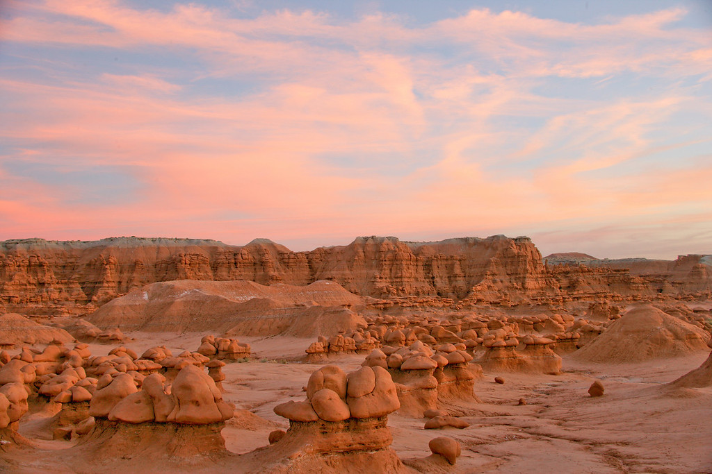 A colorful sunset warms the hoodos at Goblin Valley State Park near Hanksvillle and Green River, Utah.