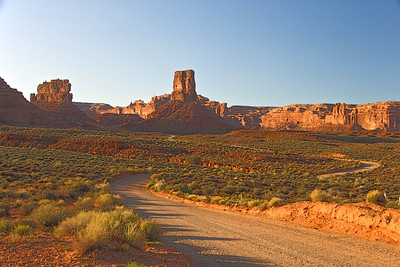 Road into Valley of the Gods at sunset.  Valley of the Gods near Bluff, Utah