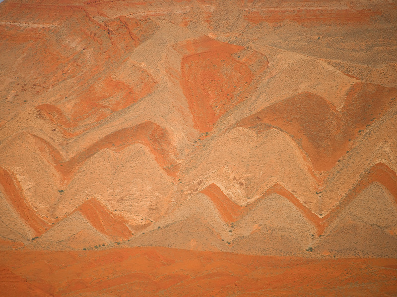 Canyon patterns outside Mexican Hat, Utah. Note the small trees along the side of the canyon.